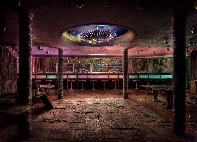 An abandoned hotel and its bar deep inside a pine forest.