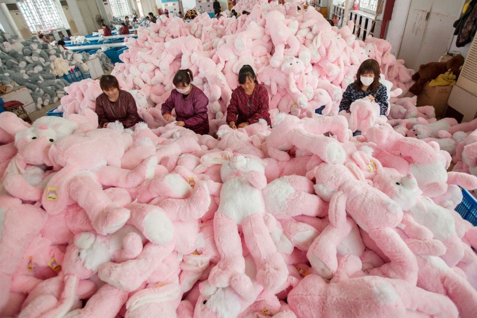 16. Employees manufacture toys at a workshop in Lianyungang, China - October 30, 2014.