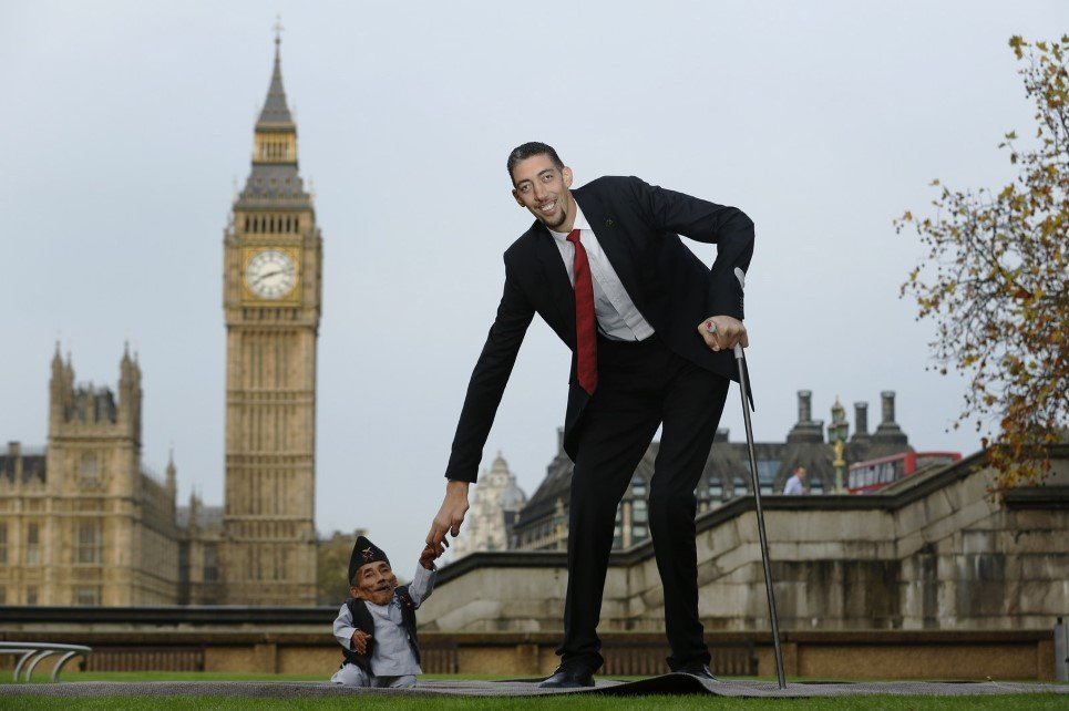 31. The world's tallest living man, Sultan Kosen and world's shortest man Chandra Bahadur Dangi greet each other at the Guinness World Records Day in London - November