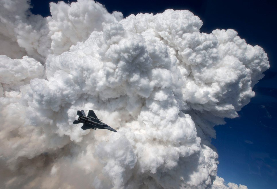 35. An F-15C captured against thick clouds formed by the Oregon Gulch wildfire.