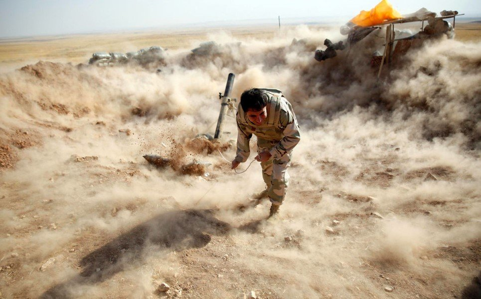 39. A Kurdish fighter launches mortar shells towards Islamic State (IS) controlled Zummar, near Mosul - September 15, 2014.