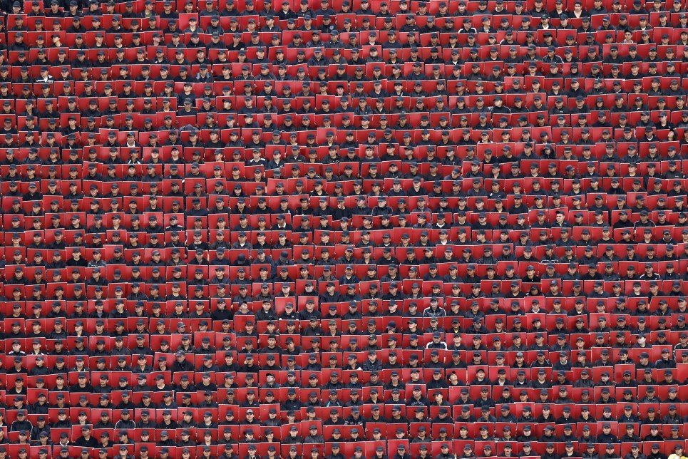 60. Troops hold colored cards during a military parade celebrating Independence Day in downtown Mexico City - September 16, 2014.