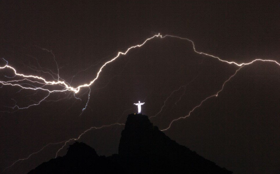 7. Lightning flashing on the top of Corcovado Hill in Rio de Janeiro - January 14, 2014.
