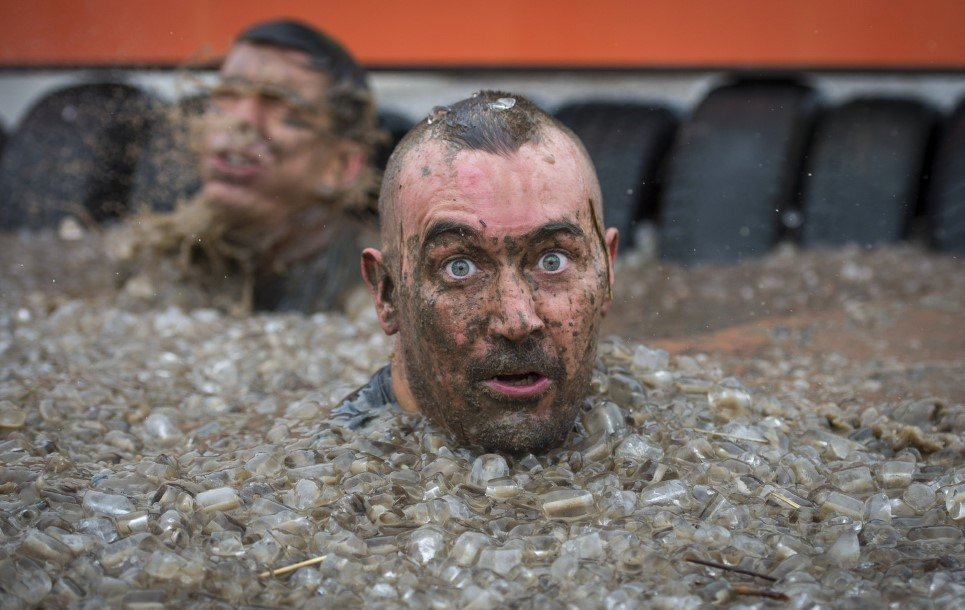 83. Competitors take part in the Tough Mudder London South in Winchester, England - October 25, 2014.