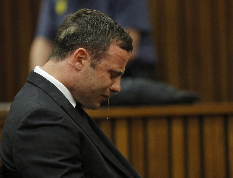 97. Olympic and Paralympic track star Oscar Pistorius reacts as he listens to Judge Thokozile Masipa's verdict at the North Gauteng High Court in Pretoria - September