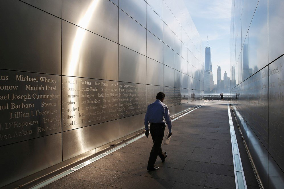 A Colombian immigrant walks through the New Jersey Empty Sky 9/11 Memorial after taking the oath of allegiance and becoming a U.S. citizen – Sept. 17, 2015.