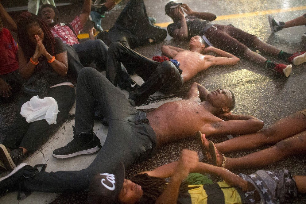 Demonstrators commemorate the one-year anniversary of the shooting of Michael Brown in Ferguson by staging a die-in – Aug. 9, 2015.
