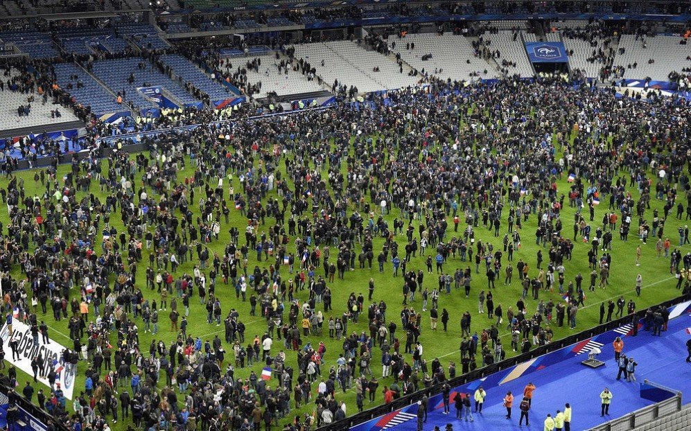 Football fans gather on the field of the Stade de France stadium following the friendly match between France and Germany, after a series of coordinated terrorist attacks across Paris in which 130 victims were killed – Nov. 13, 2015