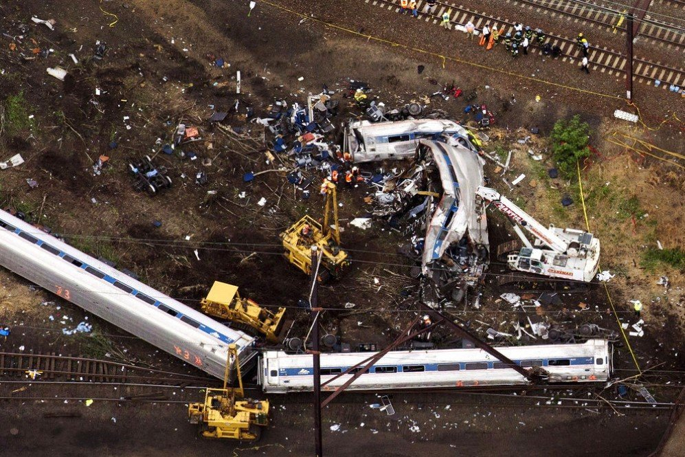 Rescue workers examine the debris of a derailed Amtrak train in Philadelphia, Pennsylvania, which killed 8 people – May 13, 2015