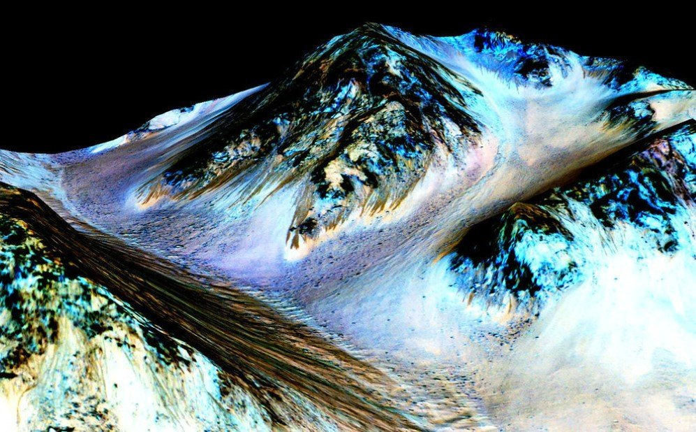 The picture shows what appears to be 100-meter-long streaks on the surface of Mars, seeming to have been formed by flowing water. – Sept. 28, 2015