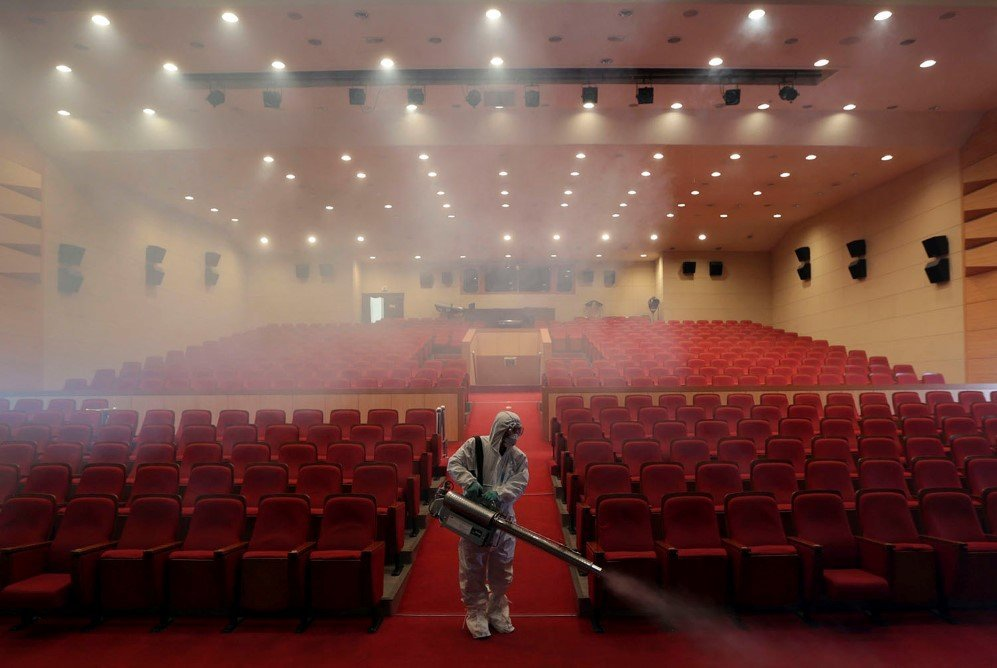 A worker sprays antiseptic solution as a precaution against the spread of MERS at an art hall in Seoul, South Korea – June 12, 2015.