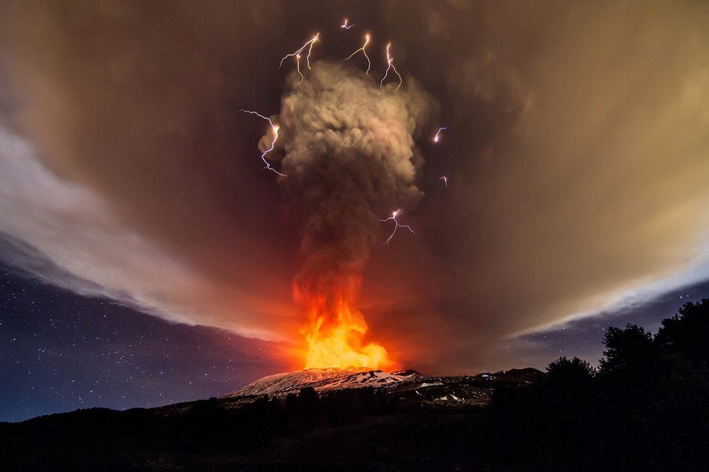 A thunderstorm with volcanic lightning seen as Mount Etna erupts.
