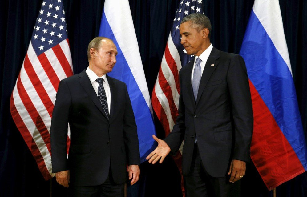 President Barack Obama extends his hand to Russian President Vladimir Putin during their meeting at the United Nations General Assembly in New York City – Sept. 28, 2015