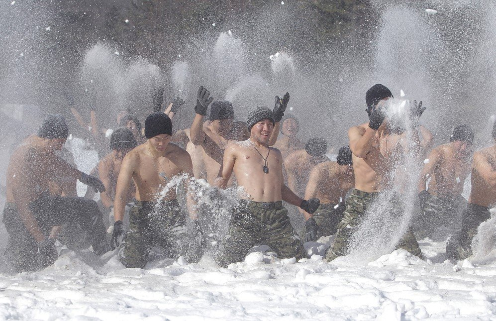 South Korean soldiers play in the snow during a winter military training exercise in Pyeongchang-gun, South Korea – Jan. 8, 2015