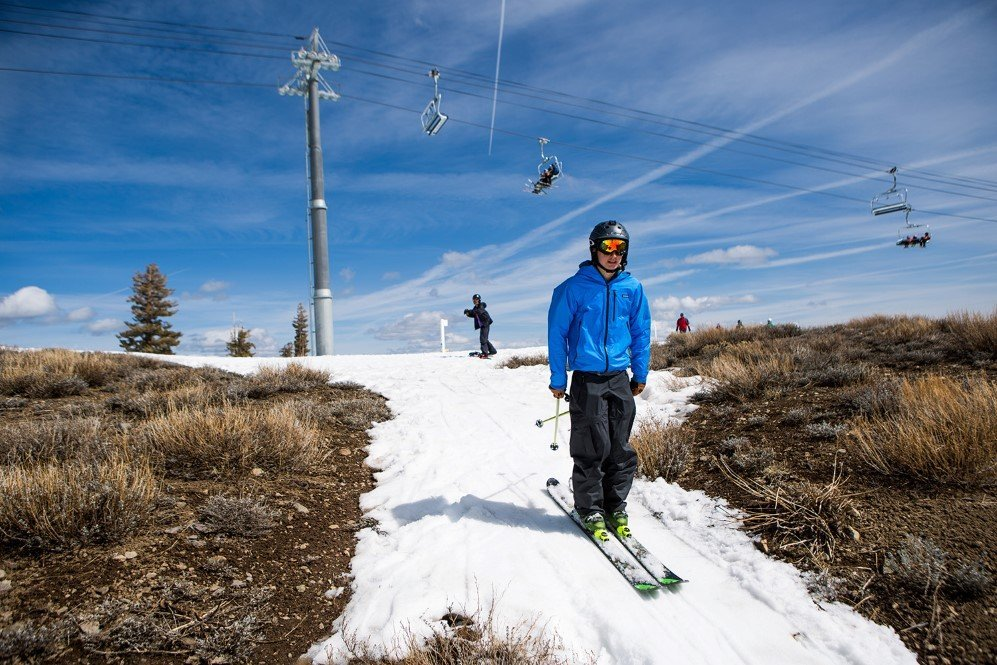 A skier threads his way through a patch of snow surrounded by dry ground at Squaw Valley Ski Resort which is a result of low snowfall caused by California's historic drought – March. 21, 2015.