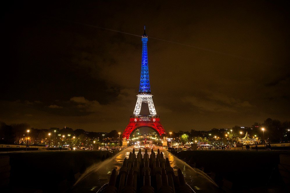 The Eiffel Tower is illuminated in the colors of the French flag to honor the victims of the Paris terror attacks.
