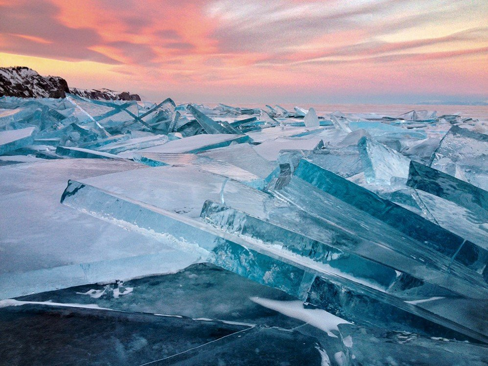This photo was taken on January 30, 2016, on Olkhon Island, Lake Baikal, Russia. It was the first ice on the lake after heavy frosts below -30C, it is titled, Baikal Ice on Sunset.