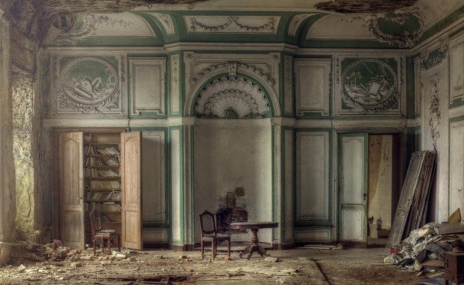'A glass of red wine please'; a wrecked room in an old manor house.