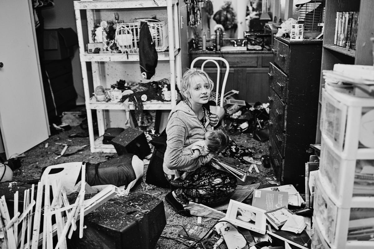 13.Melissa Golden's photograph of the scene after a tornado hit a residential house in Moore, Oklahoma, has been shortlisted in the Current Affairs category. In this picture Destiny Pierman, 13 collects belongings from the damaged bedroom of her home. She and her mother feared the house had been leveled and were relieved to find that, although it was damaged, it was still standing. Destiny's epilepsy medication, the family's primary concern, was right where they had left it. (Melissa Golden/Sony World Photography Awards)