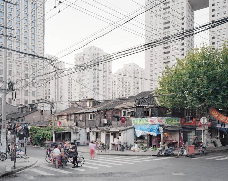 17.Shanghai City is the backdrop for a series of pictures about living places and the way we deal with public space. Photographer Arjen Schmitz said: 'I work as a fine art artist with a 8x10 inch Sinar. Working with this camera forces me to select my pictures and subject very carefully in terms of cropping, light condition, an other circumstances wich could influence my picture.' (Arjen Schmitz/Sony World Photography Awards)