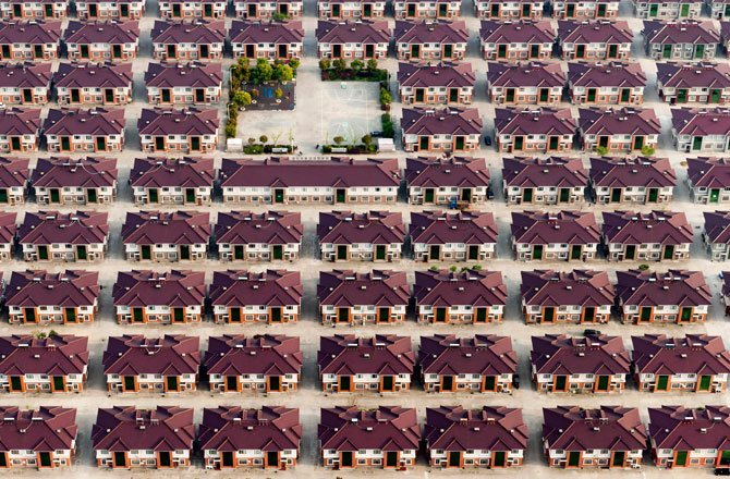 26.Rows of identical houses and a playground in Jiangyin, a city in China's Jiangsu province. (Kacper Kowalski/2014 Sony World Photography Awards)