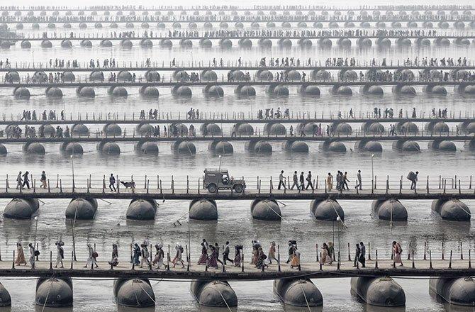 28.Hindu pilgrims and devotees of the Maha Kumbh Mela -- the largest spiritual gathering on the planet -- cross floating bridges. (Wolfgang Weinhardt/2014 Sony World Photography Awards)