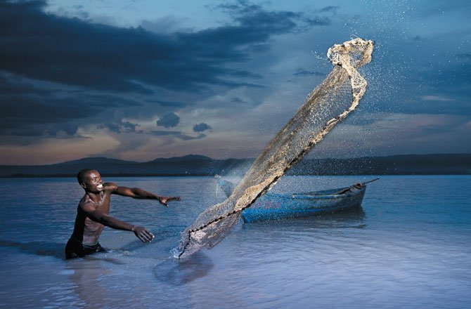 31.A fisherman in Lake Victoria casts his net near Kisumu, Kenya. (Allan Gichigi)