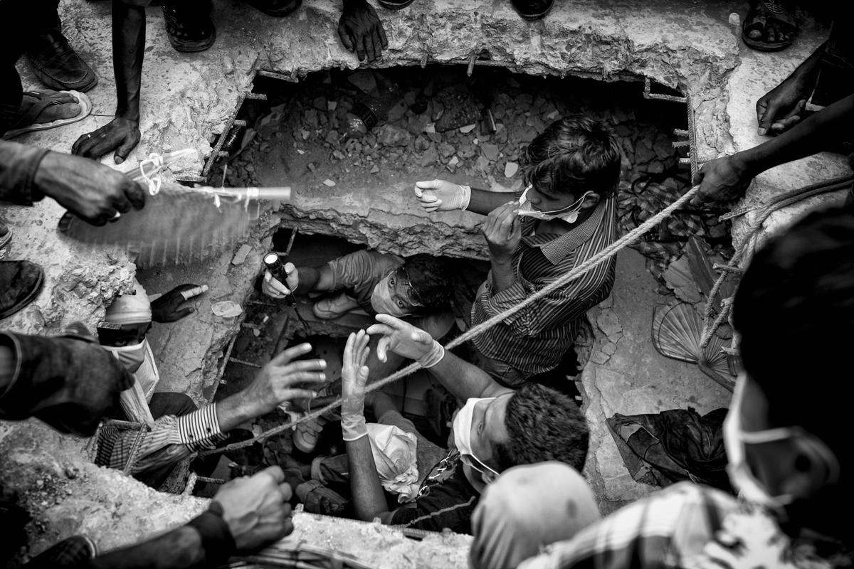 7.This picture of workers taking part in a rescue operation inside the eight‐story building Rana Plaza, which collapsed at Savar, outside Dhaka, Bangladesh, was taken by photographer K.M Asad and is one of a series shortlisted in the Current Affairs category. (K.M Asad/Sony World Photography Awards)