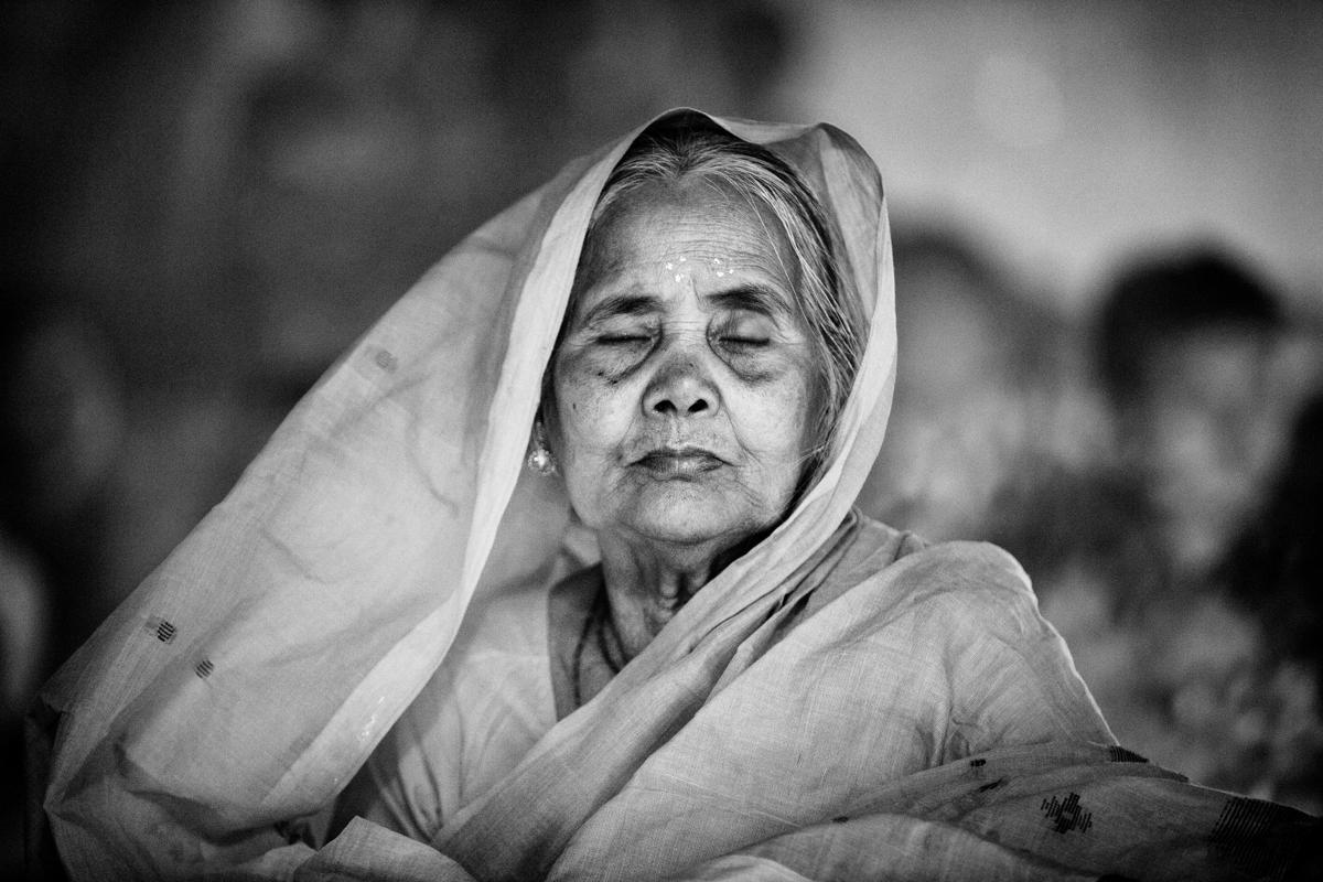 10.An old Hindu woman sits and prays in front of the Shri Shri Lokanath Brahmachar Ashram Temple during the Rakher Upobash at Barodi, Narayangonj. Hindu devotees fast and pray to gods during the ritual called Kartik Brati or Rakher Upobash. This image, taken by Suvra Kanti Das, has been shortlisted in the Arts and Culture category. (Suvra Kanti Das/Sony World Photography Awards)