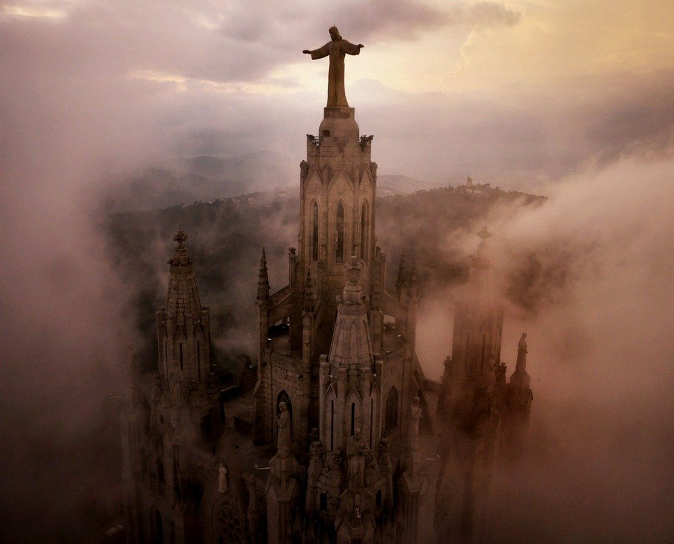 16. Clouds surround the the Temple Expiatori del Sagrat Cor Church in Barcelona.