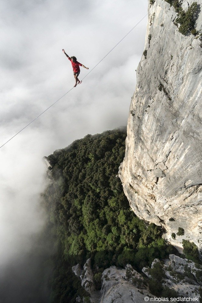 6. Theo Sanson balances himself on a 280 feet long highline at 980 feet of altitude with thick clouds in the back drop in Les Gorges Du Verdon in France.
