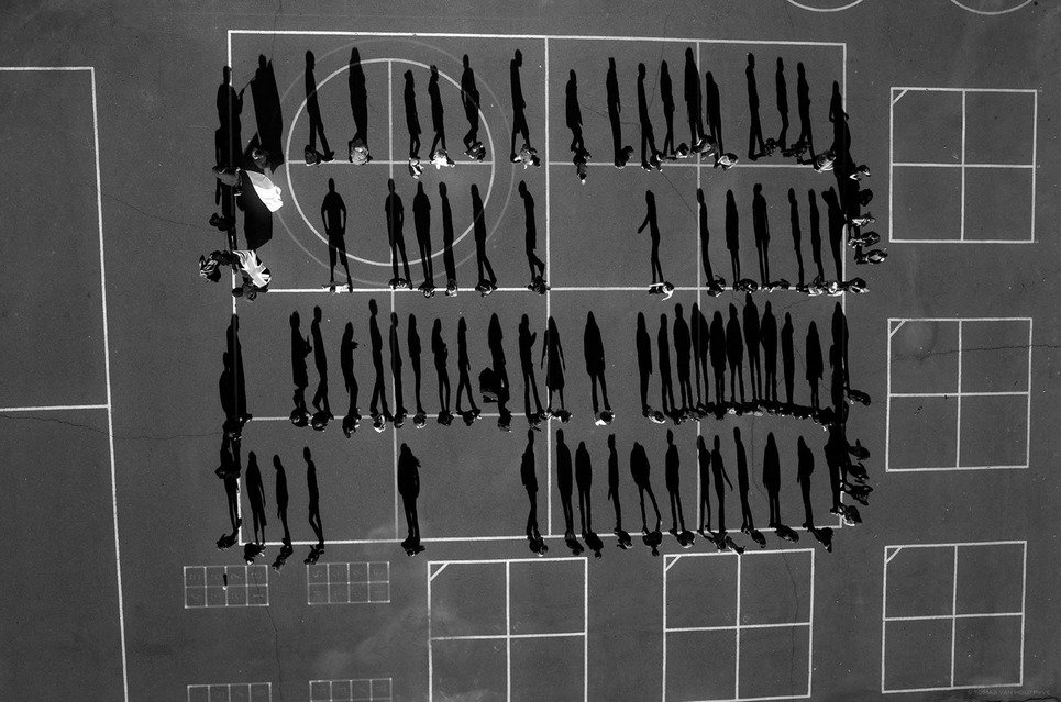 8. Students with their shadow trails are seen in a schoolyard in El Dorado County, California.