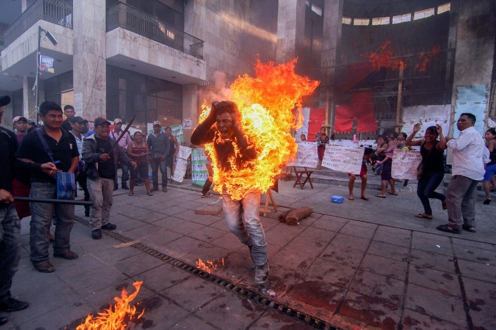36. Agustin Gomez Perez; a 21 year old farmer sets himself on fire to stage a protest outside the Chiapas state legislature in Tuxtla Gutierrez, Mexico - December 5, 2