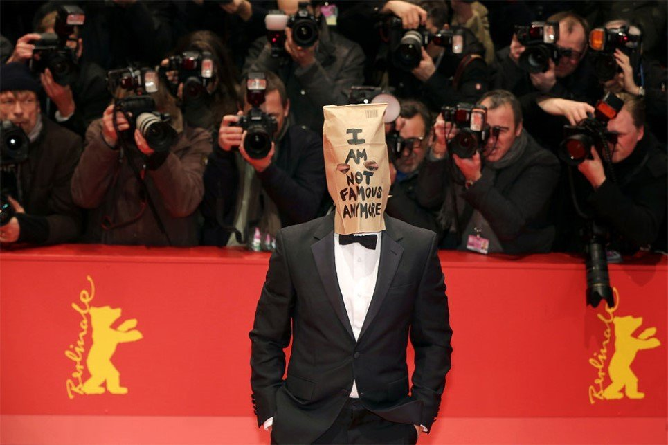 "77. Actor Shia Labeouf arrives for the screening of ""Nymphomaniac Volume I""wearing a paper bag that reads ""I am not famous anymore"" at the 64th Annual Berlin Film Fest"