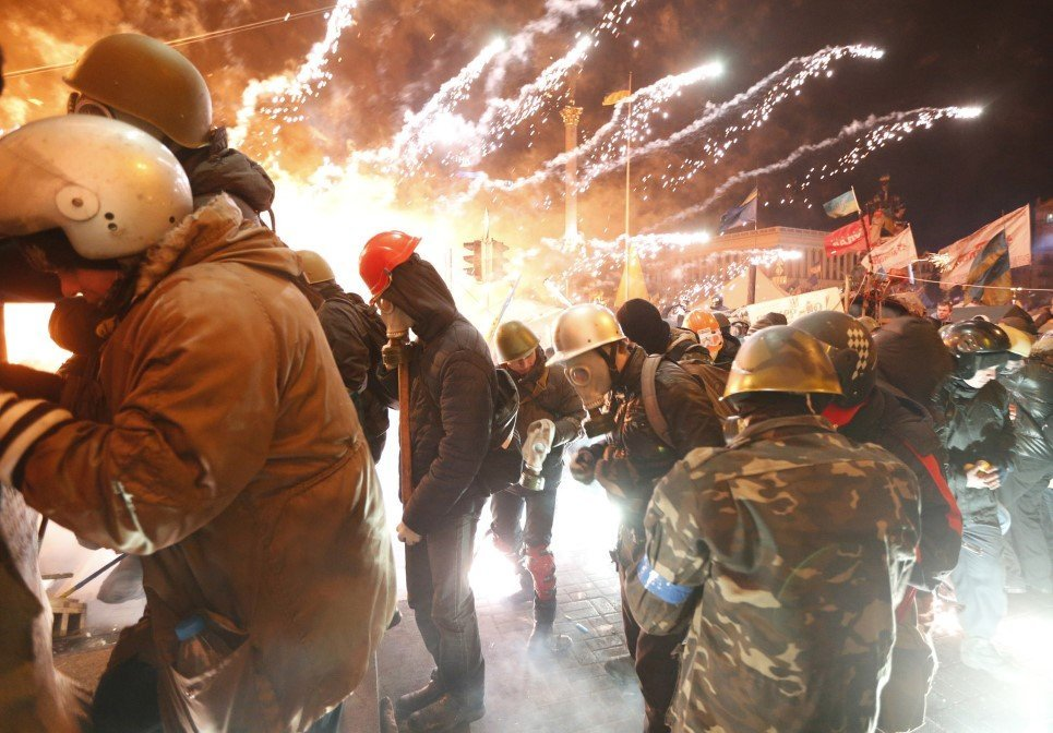 9. Fireworks explode near anti-government protesters during clashes with riot police at the Independence Square in Kiev - February 18, 2014.