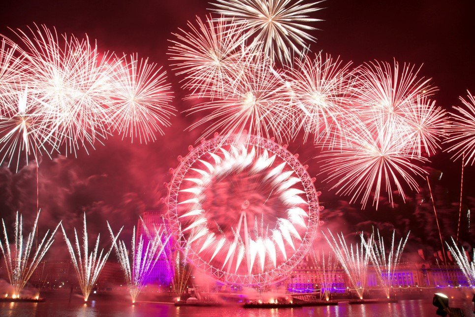 Fireworks over the iconic London Eye marking the coming of the New Year in Central London, Britain, 01 January 2013. Over 250,000 people were expected to take part in the festivities on the banks of the river Thames. EPA/GEORGE HENTON