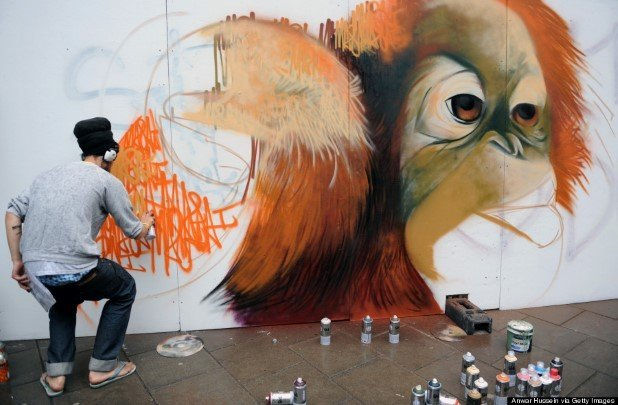 A graffiti artist puts the finishing touches to his painting for the See No Evil street art project in Nelson Street on August 20, 2011 in Bristol, England. The project is Europe's biggest street art festival and has attracted top graffiti artists from all over the world. Organisers hope it will become a major tourist attraction for Bristol, the spiritual home of Banksy.