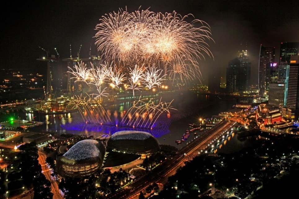 Fireworks light up the skyline of the financial district to usher in the New Year on Jan. 1, 2010 in Singapore.(AP Photo/Wong Maye-E)
