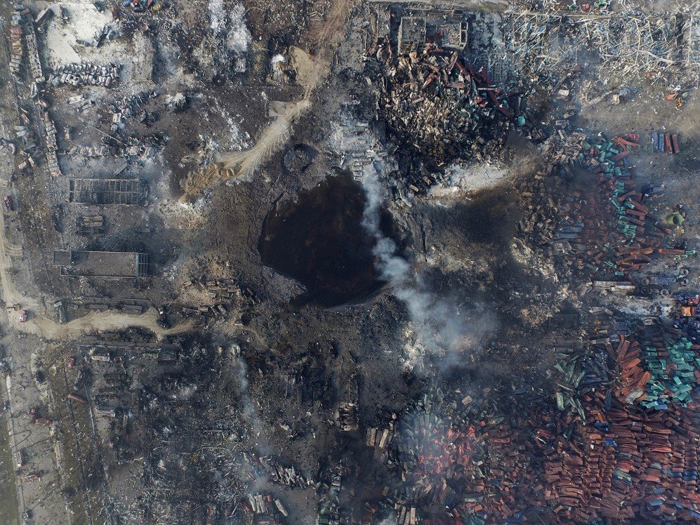 An aerial view of a large crater that was formed in the aftermath of a huge explosion that rocked the port city of Tianjin, China. At least 85 people were killed – Aug. 12, 2015.