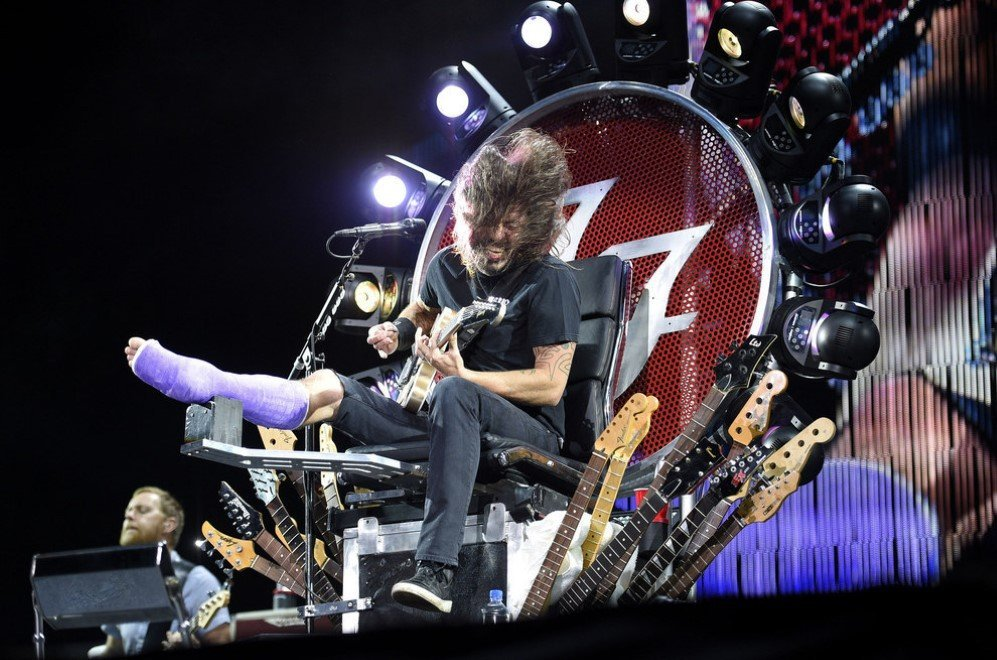 Dave Grohl  of 'The Foo Fighters' performs on a throne of guitars with a broken foot at RFK Stadium, Washington, D.C. – July 4, 2015