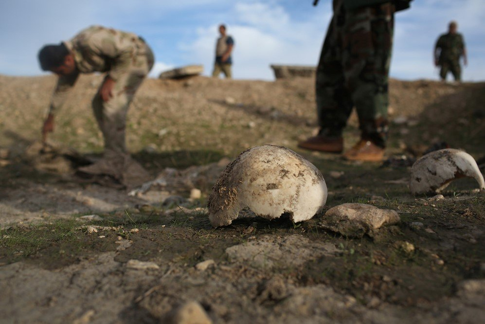 After emancipating the city from the Islamic State, Kurdish Peshmerga show what they say is a mass grave in Sinjar, Iraq of more than 50 Yazidis killed by ISIS – Nov. 15, 2015
