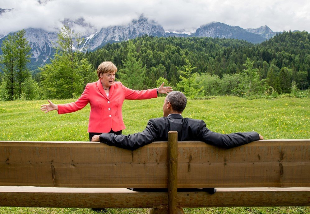 German chancellor Angela Merkel talks to U.S. president Barack Obama in Elmau, Germany – June 8, 2015.