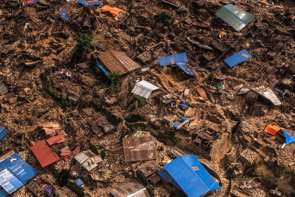 Damaged houses are seen from an Indian Helicopter in Khanigaun, Nepal after a major 7.9 earthquake jolted Kathmandu on April 25. Many houses, buildings, and temples in the capital were destroyed during the earthquake, leaving over 7,000 people dead and many more trapped under the debris.