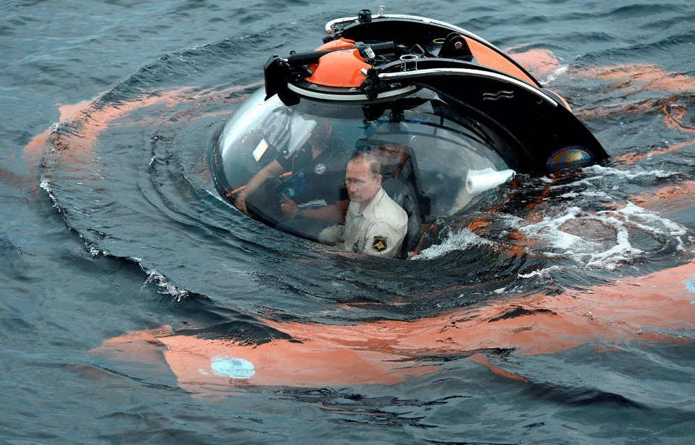 Russian President Vladimir Putin, sits on board a bathyscaphe as it dives into the Black sea along the coast of Sevastopol, Crimea – Aug. 18, 2015.