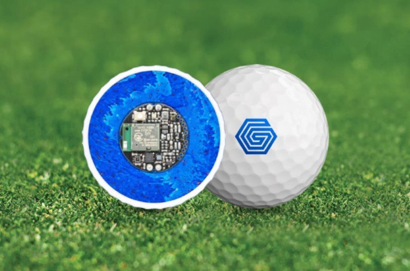 Golf ball with hardware